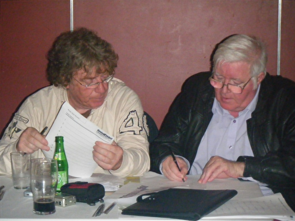 Sean Callaghan and Jimmy Neary Count keep track of the scores at the Dundalk FM Music Quiz in the Lisdoo Steak House.
